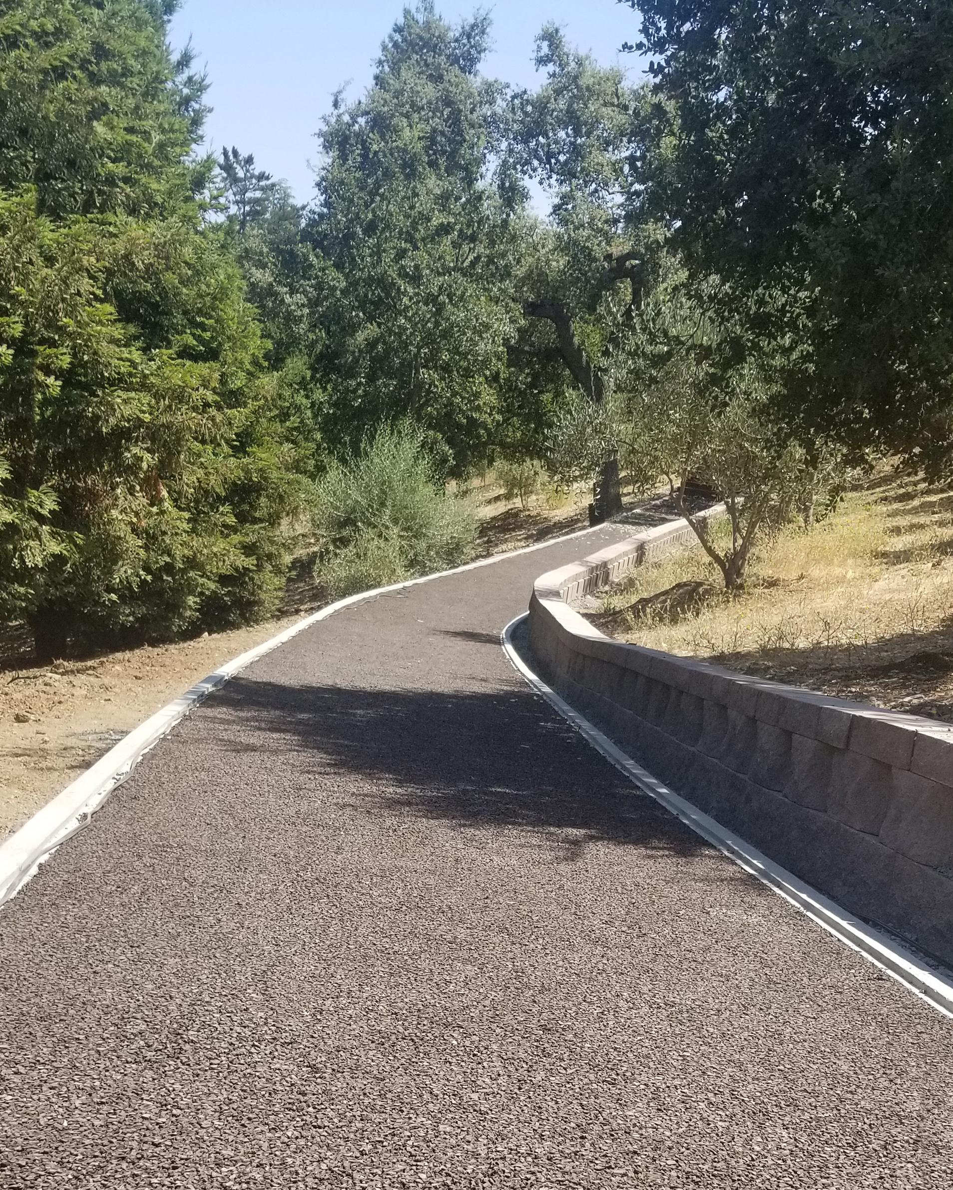 Rubberway flexible porous pavement trail