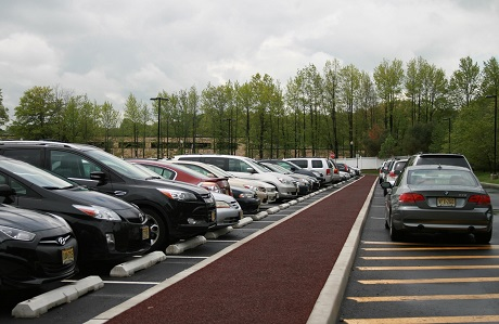 Rubberway pervious rubber pavement parking lot at Bed Bath & Beyond for stormwater management