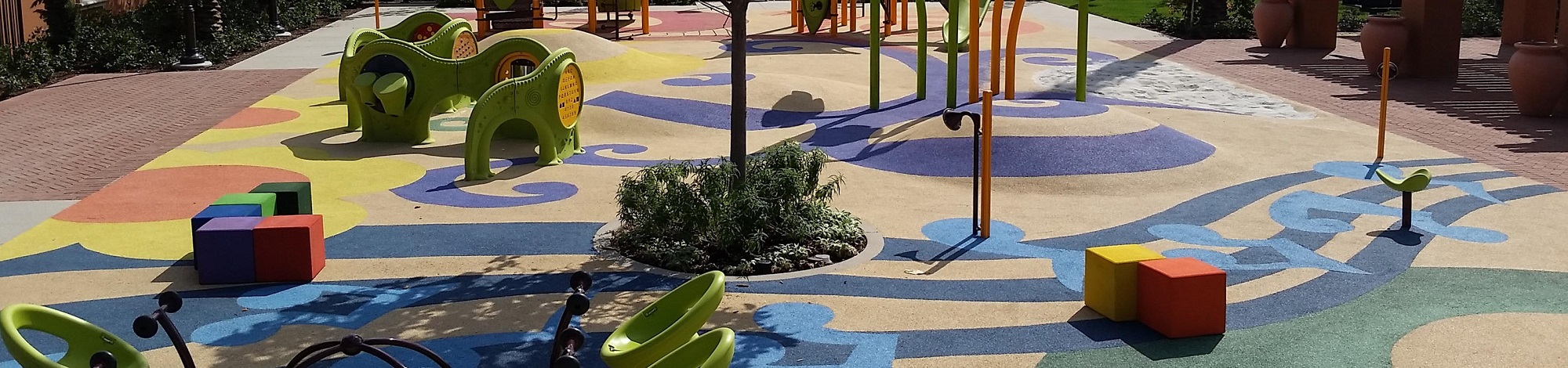Rubber playground safety surfacing with colorful designs