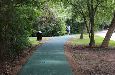 Rubberway pervious rubber jogging trail on hotel grounds for stormwater management