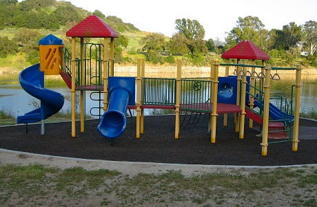 recycled rubber mulch is pigmented in a variety of colors and bound with polyurethane binder so it is a single layer system that is easy to maintain and an alternative to woodchips.