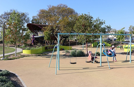 Natural Colored Playground Surfacing Beneath Swings
