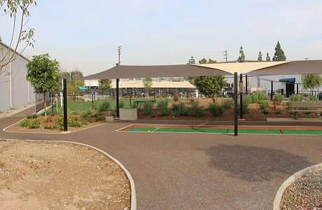 Rubberway Rubber Fitness Trail Surrounding Bocce Ball Court at Corporate Campus